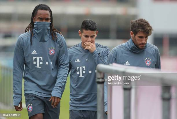 Renato Sanches James Rodriguez and Javi Martinez of FC Bayern Muenchen arrive for a training session at the club's Saebener Strasse training court on...