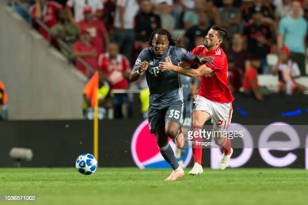 Renato Sanches of Bayern Muenchen and Pizzi of Benfica Lissabon battle for the ball during the UEFA Champions League Group E match between SL Benfica...