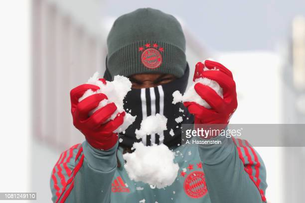 Renato Sanches of Bayern Muenchen plays with snow prior to a Bayern Muenchen training session at Saebener Strasse training ground on January 12 2019...