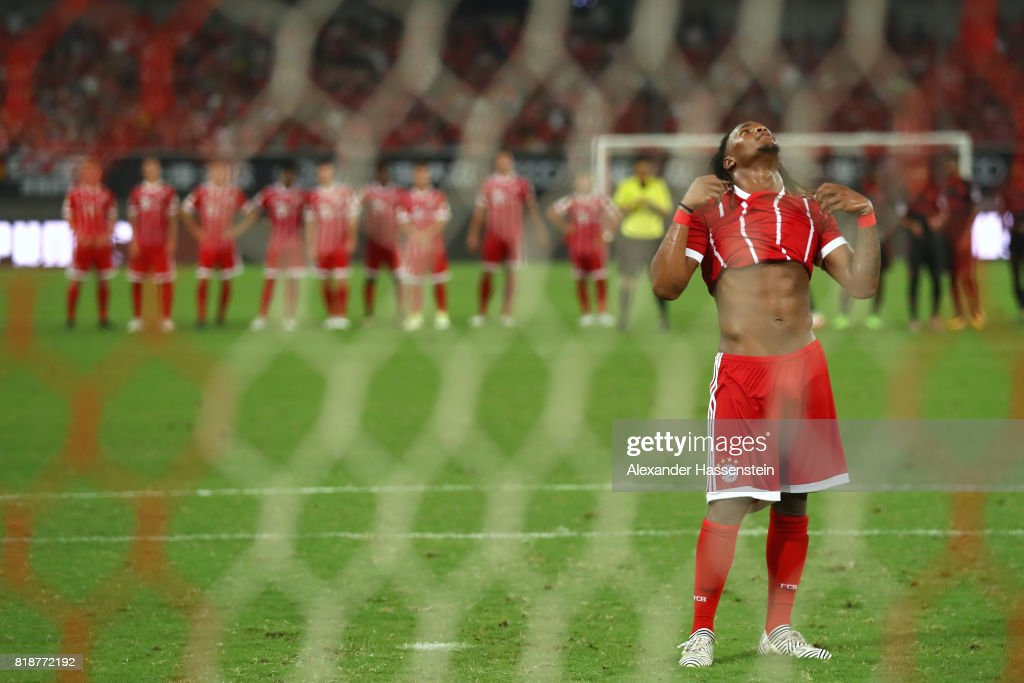 Renato Sanches of Bayern Muenchen reacts after missing a penalty during the penalty shoot-out of the Audi Football Summit 2017 match between Bayern Muenchen and Arsenal FC at Shanghai Stadium during the Audi Summer Tour 2017 on July 19, 2017 in Shanghai, China.