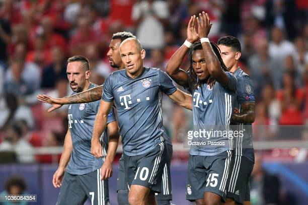 Renato Sanches of Bayern Munich celebrates after scoring his team's second goal with his team mates during the Group E match of the UEFA Champions...
