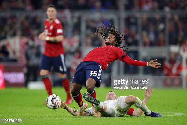 Renato Sanches of Bayern Munich is challenged by Oliver Fink of Fortuna Duesseldorf during the Bundesliga match between FC Bayern Muenchen and...