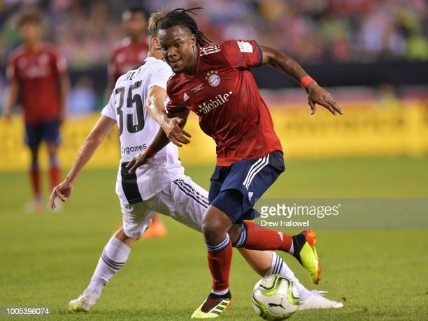 Renato Sanches of Bayern Munich takes the ball past Roman Macek of Juventus during the International Champions Cup 2018 match between Juventus and FC...