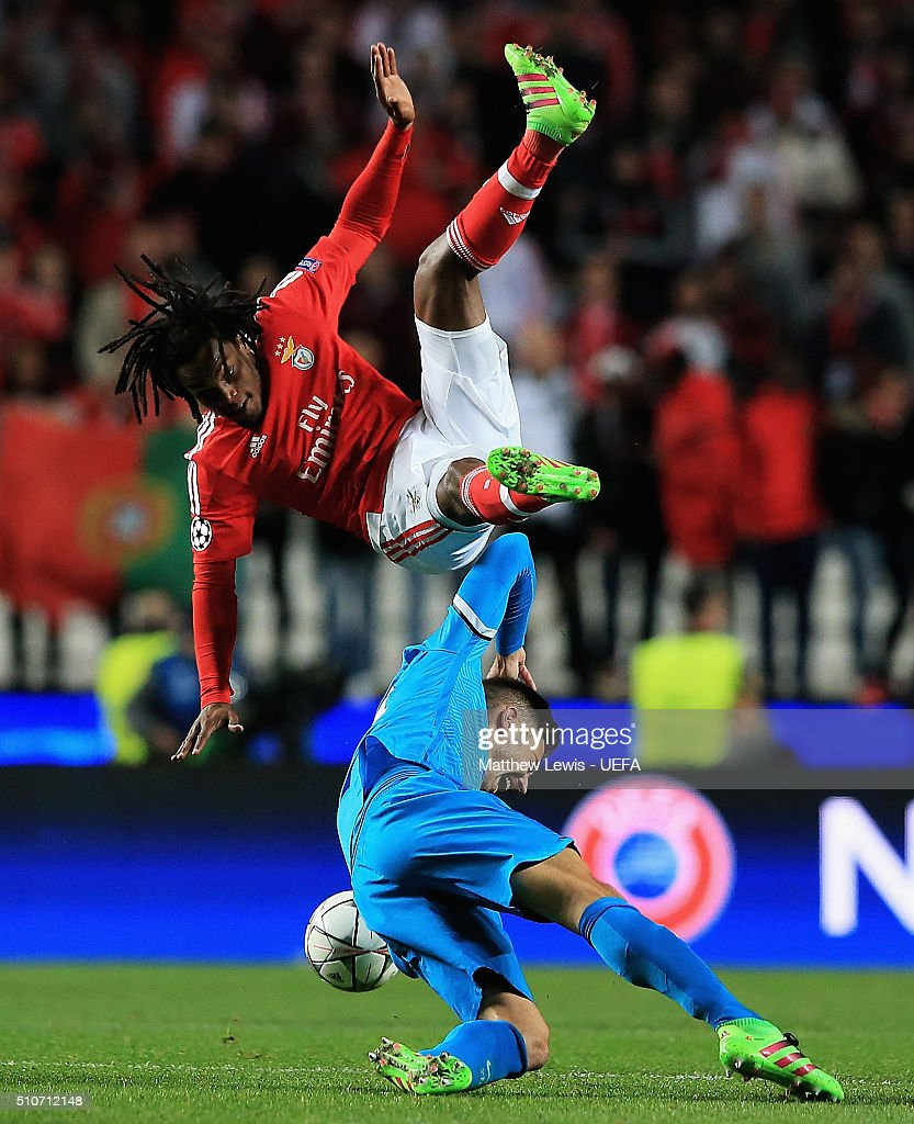 Renato Sanches of Benfica and Javi Garcia of FC Zenit challenge for the ball during the first leg of the UEFA Champions League Round of 16 match between SL Benfica and FC Zenit at Estadio da Luz on February 16, 2016 in Lisbon, Portugal.