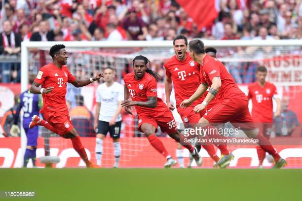 Renato Sanches of FC Bayern München celebrates with teammates after scoring his team's third goal during the Bundesliga match between FC Bayern...