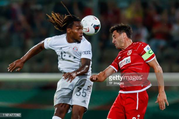 Renato Sanches of FC Bayern Muenchen and Dimitar Rangelov of Energie Cottbus battle for the ball during the DFB Cup first round match between Energie...