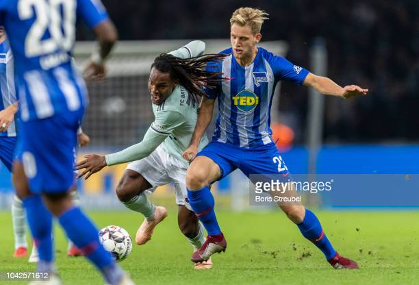 Renato Sanches of FC Bayern Muenchen battles for the ball with Arne Maier of Hertha BSC during the Bundesliga match between Hertha BSC and FC Bayern...
