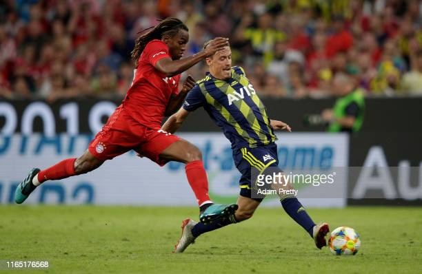 Renato Sanches of Muenchen challenges Max Kruse of Fenerbahce during the Audi Cup 2019 semi final match between FC Bayern Muenchen and Fenerbahce at...