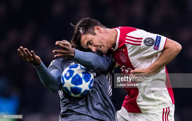 Renato Sanches of Munich and Nicolas Tagliafico of Amsterdam head the ball during the UEFA Champions League Group E match between Ajax Amsterdam and...