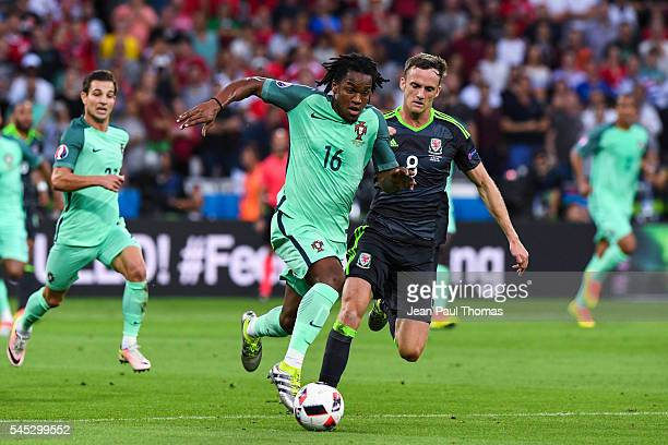 Renato Sanches of Portugal and Andy King of Wales during the Uefa Euro Semi final between Wales and Portugal at Stade des Lumieres on July 6 2016 in...