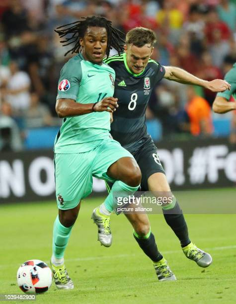 Renato Sanches of Portugal and Andy King of Wales vie for the ball during the UEFA EURO 2016 semi final soccer match between Portugal and Wales at...