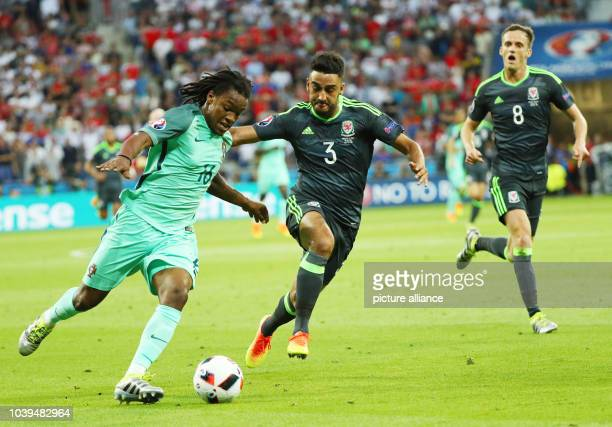 Renato Sanches of Portugal and Neil Taylor and Andy King of Wales vie for the ball during the UEFA EURO 2016 semi final soccer match between Portugal...