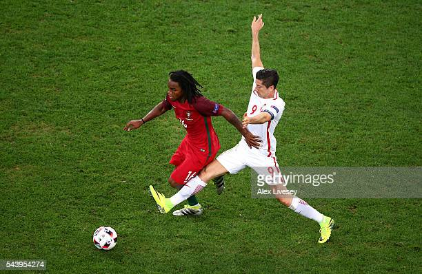 Renato Sanches of Portugal and Robert Lewandowski of Poland compete for the ball during the UEFA EURO 2016 quarter final match between Poland and...