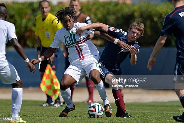 Renato Sanches of Portugal battles for the ball with Aidan Nesbitt of Scotland during the UEFA Under17 European Championship 2014 group B match...