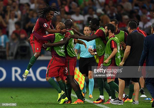 Renato Sanches of Portugal celebrates scoring his team's first goal with his team mates during the UEFA EURO 2016 quarter final match between Poland...