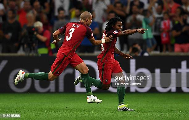 Renato Sanches of Portugal celebrates scoring his team's first goal with his team mate Pepe during the UEFA EURO 2016 quarter final match between...