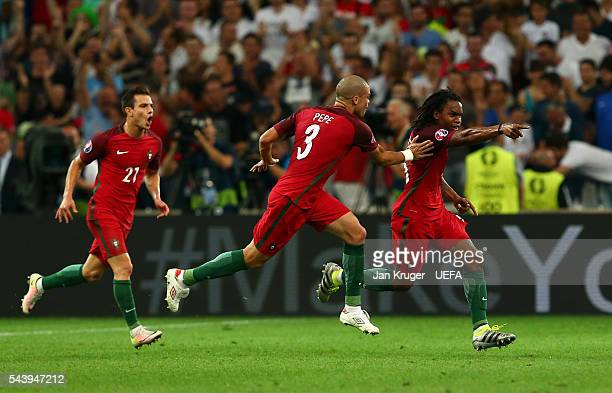 Renato Sanches of Portugal celebrates scoring his team's first goal with his team mate Pepe and Cedric Soares during the UEFA EURO 2016 quarter final...