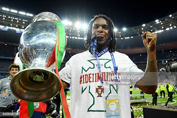 Renato Sanches of Portugal holds the Henri Delaunay trophy to celebrate after his team's 10 win against France in the UEFA EURO 2016 Final match...