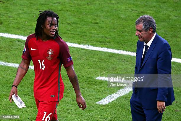 Renato Sanches of Portugal talks to head coach Fernando Santos after substituted during the UEFA EURO 2016 Final match between Portugal and France at...