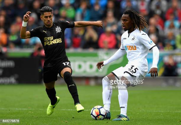 Renato Sanches of Swansea City and Ayoze Perez of Newcastle United during the Premier League match between Swansea City and Newcastle United at...