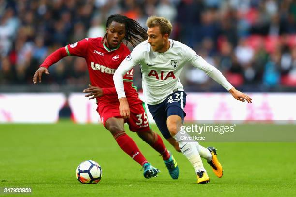 Renato Sanches of Swansea City and Christian Eriksen of Tottenham Hotspur battle for possession during the Premier League match between Tottenham...