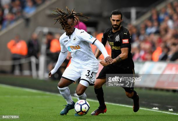 Renato Sanches of Swansea City and Jesus Gamez of Newcastle United in action during the Premier League match between Swansea City and Newcastle...
