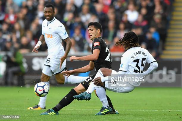Renato Sanches of Swansea City and Mikel Merino of Newcastle United clash during the Premier League match between Swansea City and Newcastle United...