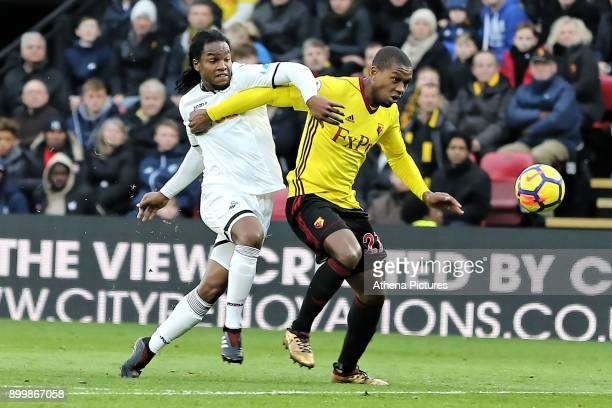 Renato Sanches of Swansea City challenges Christian Kabasele of Watford during the Premier League match between Watford and Swansea City at the...