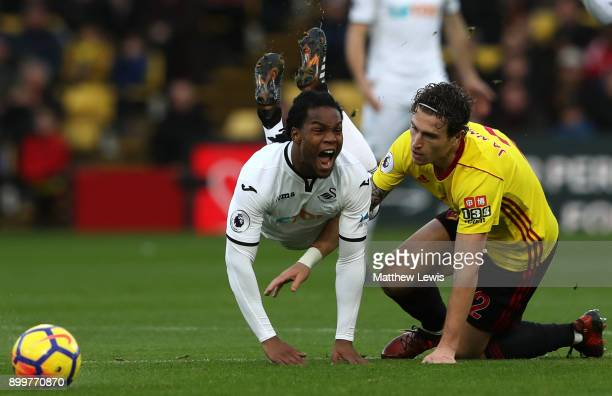 Renato Sanches of Swansea City goes to ground after a challenge from Daryl Janmaat of Watford during the Premier League match between Watford and...