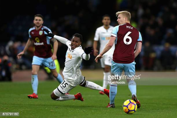 Renato Sanches of Swansea City is challenged by Ben Mee of Burnley during the Premier League match between Burnley and Swansea City at Turf Moor on...