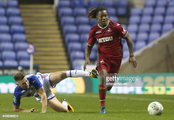 Renato Sanches of Swansea City is challenged by George Evans of Reading during the Carabao Cup Third Round match between Reading and Swansea City at...