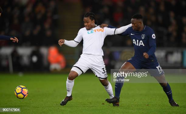 Renato Sanches of Swansea City is challenged by Victor Wanyama of Tottenham Hotspur during the Premier League match between Swansea City and...