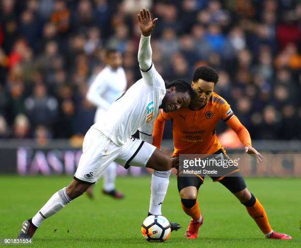 Renato Sanches of Swansea City is tackled by Helder Costa of Wolverhampton Wanderers during the The Emirates FA Cup Third Round match between...