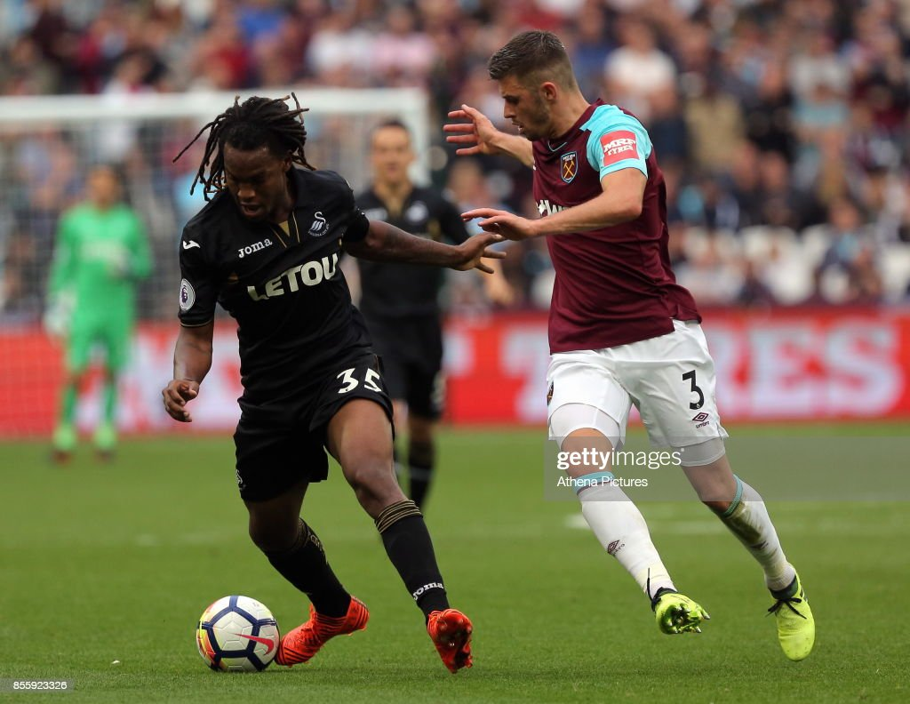 Renato Sanches of Swansea City marked by Aaron Cresswell of West Ham during the Premier League match between West Ham United v Swansea City at the London Stadium on September 30, 2017 in Swansea, Wales.