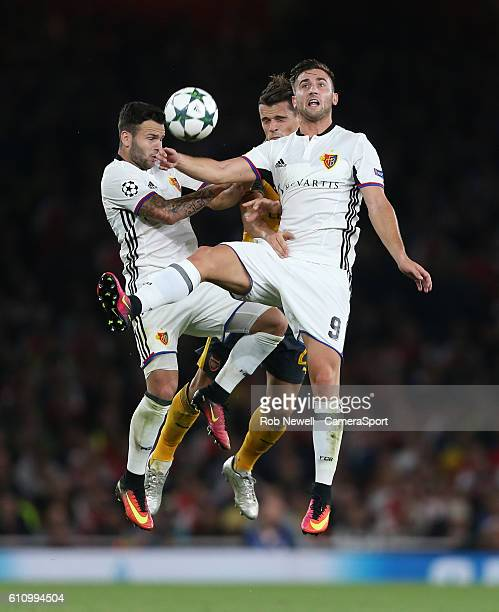 Renato Steffen and Basel's Andraz Sporar challenge Arsenal's Granit Xhaka during the UEFA Champions League match between Arsenal FC and FC Basel 1893...