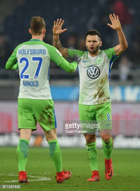 Renato Steffen and Maximilian Arnold of Wolfsburg celebrate after the Bundesliga match between Hannover 96 and VfL Wolfsburg at HDIArena on January...