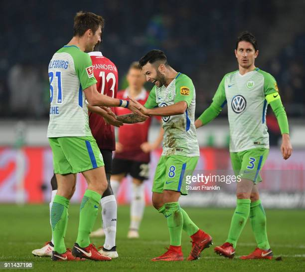 Renato Steffen and Robin Knoche of Wolfsburg celebrate after the Bundesliga match between Hannover 96 and VfL Wolfsburg at HDIArena on January 28...