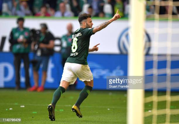 Renato Steffen of VfL Wolfsburg celebrates after scoring his team's first goal during the Bundesliga match between VfL Wolfsburg and Hannover 96 at...