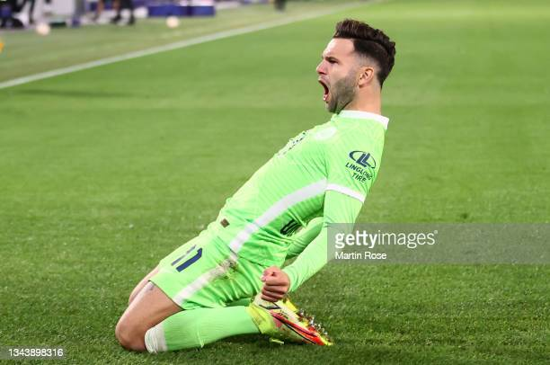 Renato Steffen of VfL Wolfsburg celebrates scoring his sides opening goal during the UEFA Champions League group G match between VfL Wolfsburg and...