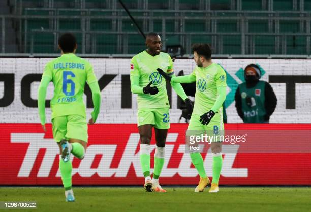 Renato Steffen of VfL Wolfsburg celebrates with team mate Josuha Guilavogui after scoring their side's second goal during the Bundesliga match...
