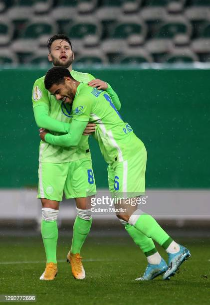 Renato Steffen of Vfl Wolfsburg celebrates with team mate Paulo Otavio Rosa Silva after their sides second goal scored by Wout Weghorst during the...