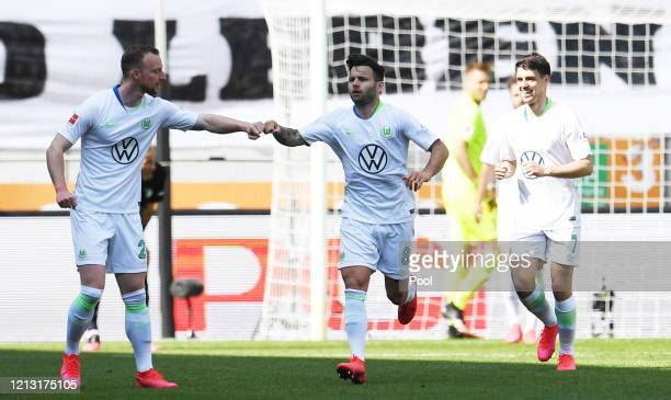 Renato Steffen of VfL Wolfsburg celebrates with teammate Maximilian Arnold after scoring their team's first goal during the Bundesliga match between...