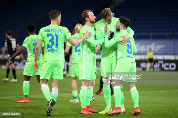 Renato Steffen of VfL Wolfsburg celebrates with teammates Yannick Gerhardt, Maximilian Arnold and Wout Weghorst after scoring their team's first goal...