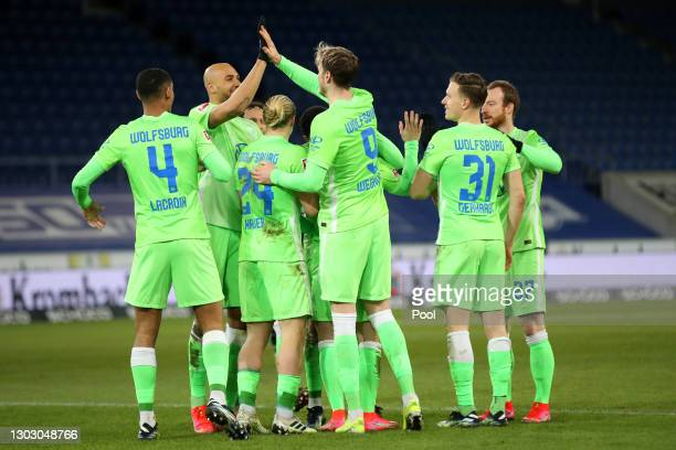 Renato Steffen of VfL Wolfsburg celebrates with Wout Weghorst and teammates after scoring their team's second goal during the Bundesliga match...