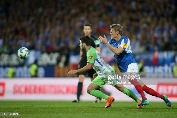 Renato Steffen of VfL Wolfsburg fights for the ball with Johannes van den Bergh of Holstein Kiel during the Bundesliga Playoff Leg 2 between Holstein...