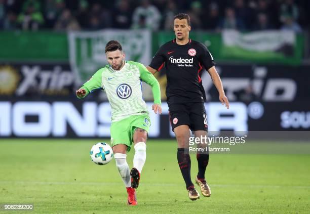 Renato Steffen of Wolfsburg and Timothy Chandler of Frankfurt vie during the Bundesliga match between VfL Wolfsburg and Eintracht Frankfurt at...
