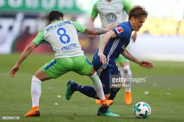 Renato Steffen of Wolfsburg fights for the ball with Gotoku Sakaiof Hamburg during the Bundesliga match between VfL Wolfsburg and Hamburger SV at...
