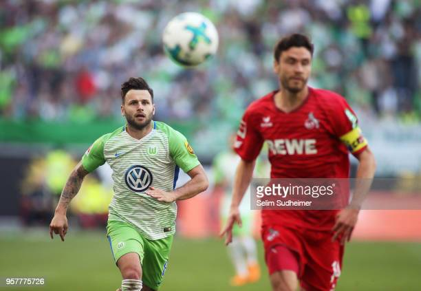 Renato Steffen of Wolfsburg fights for the ball with Jonas Hector of Koeln during the Bundesliga match between VfL Wolfsburg and 1 FC Koeln at...