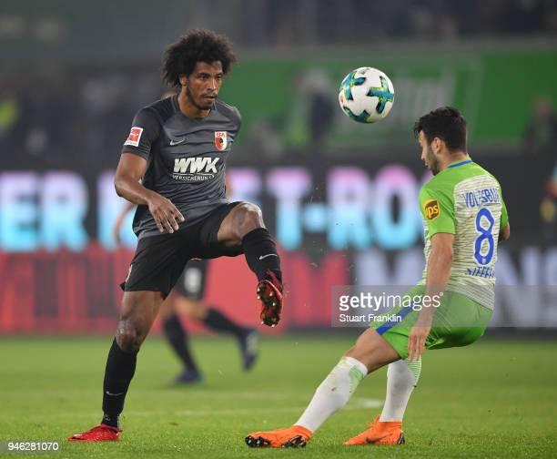 Renato Steffen of Wolfsburg is challenged by Caiuby of Augsburg during the Bundesliga match between VfL Wolfsburg and FC Augsburg at Volkswagen Arena...