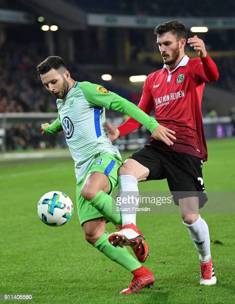 Renato Steffen of Wolfsburg is challenged by Josip Elez of Hannover during the Bundesliga match between Hannover 96 and VfL Wolfsburg at HDIArena on...